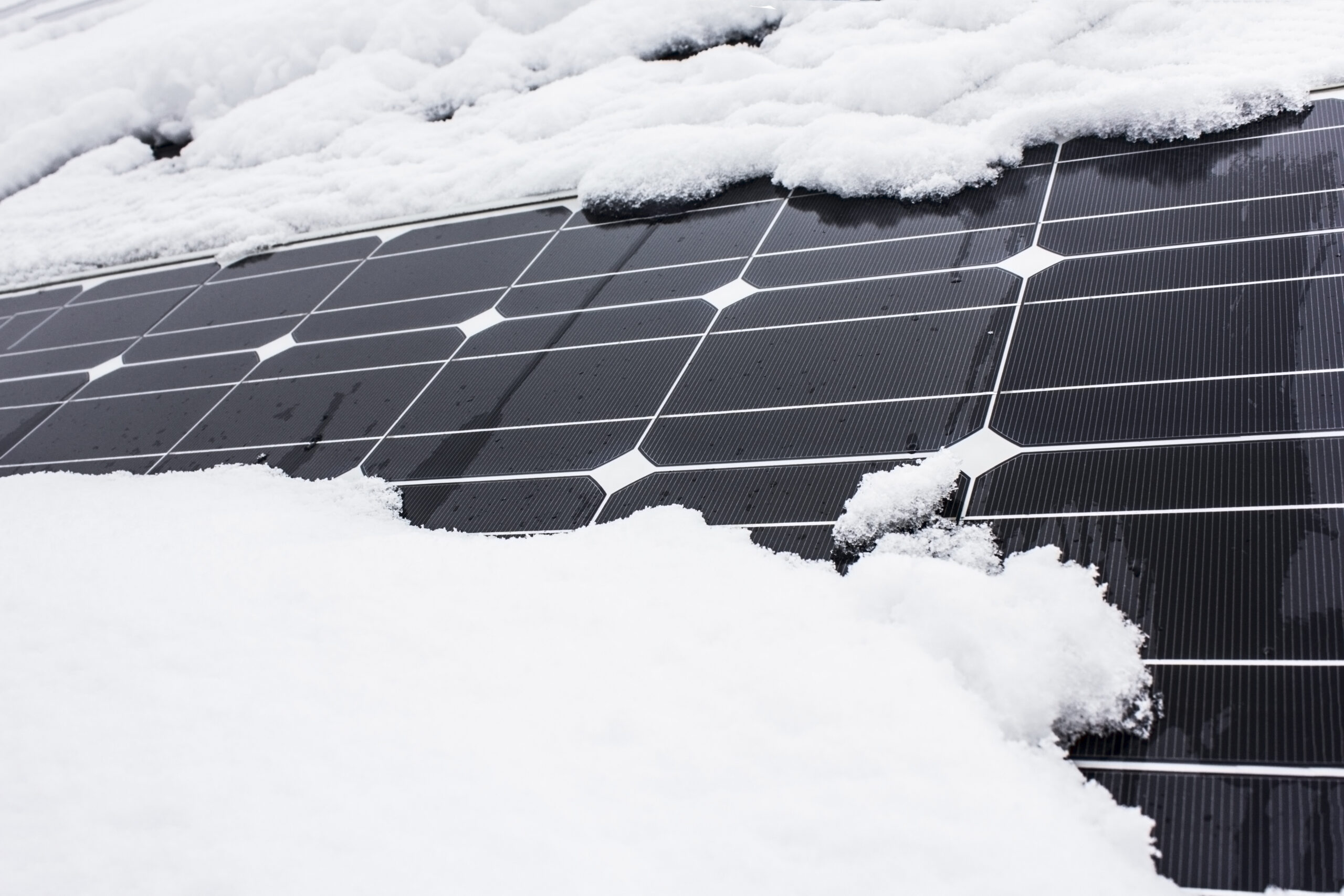 solar panels on home covered in snow